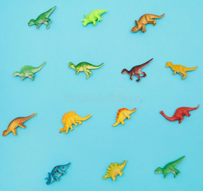 Collection of dinosaurs toys. Collection of dinosaurs toys on blue background royalty free stock images