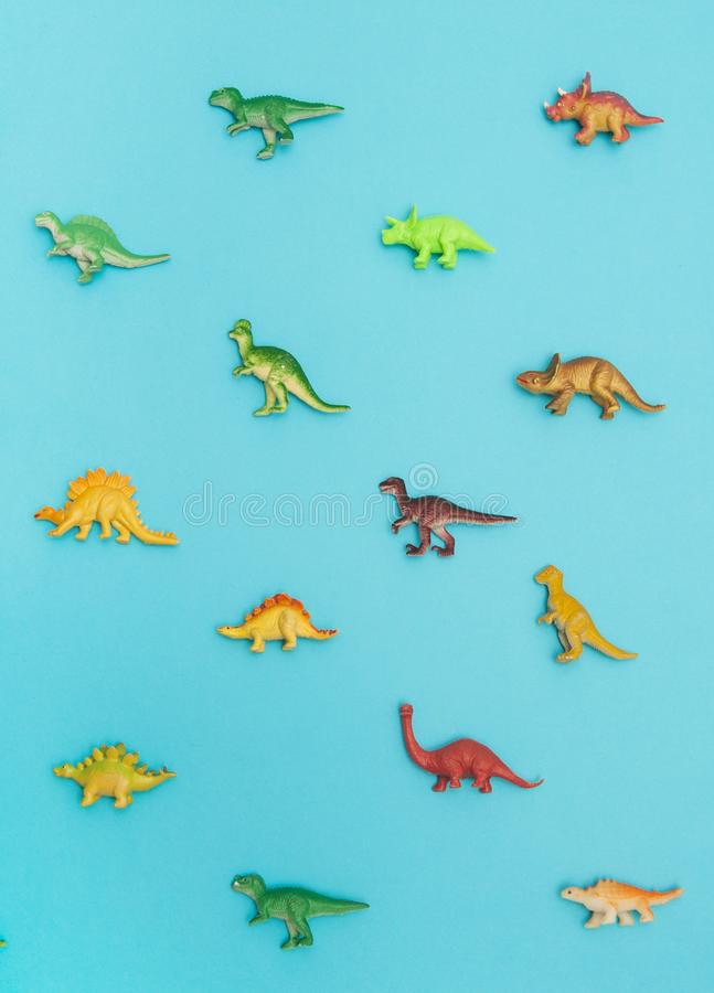 Collection of dinosaurs toys. Collection of dinosaurs toys on blue background stock photos