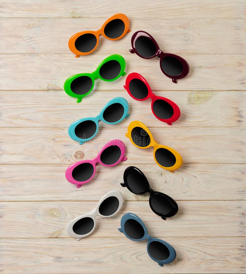 Collection of fashionable multi-colored sunglasses - a trend of royalty free stock photography