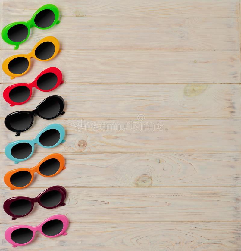 Collection of fashionable multi-colored sunglasses - a trend of stock photo