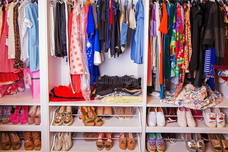Collection of female shoes with clothes. Collection of women`s shoes with clothes royalty free stock photos