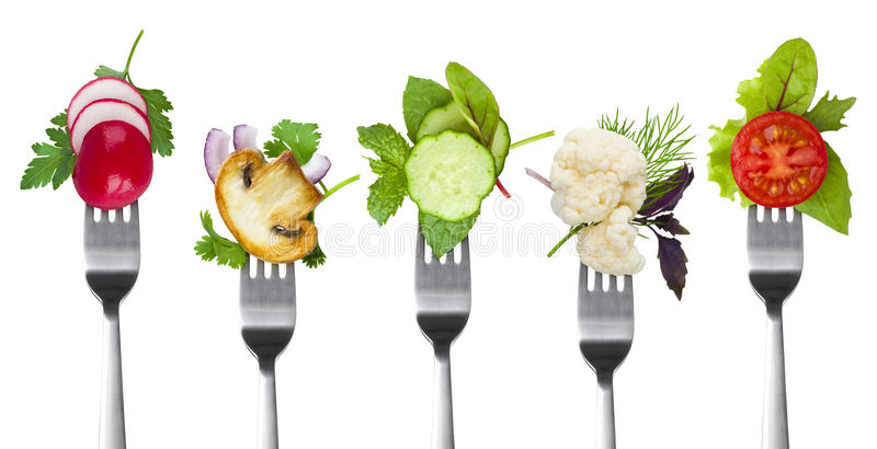 Collection of forks with herbs and vegetables isolated on white stock photography