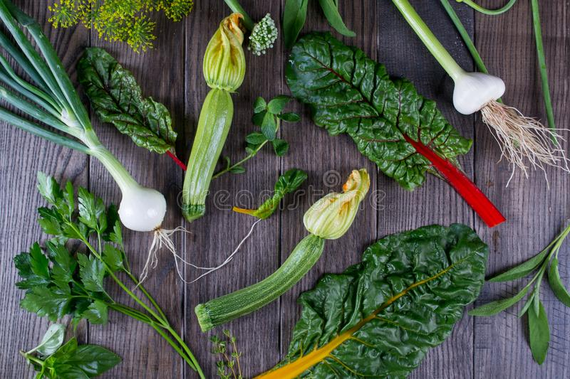 Collection of fresh green vegetables on wooden rustic background royalty free stock photo
