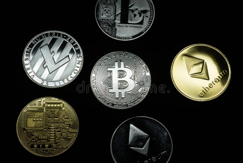 A collection of gold and silver cryptocurrency coins stock photo