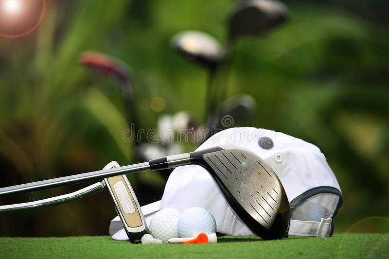 Collection of golf equipment resting on green grass. With green background royalty free stock photography