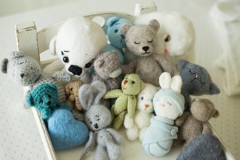 Collection of handmade toys. knitted goods, felted wool and cotton stitched animals.  royalty free stock photo