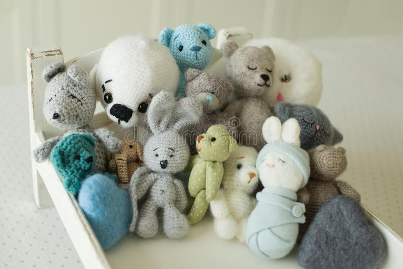 Collection of handmade toys. knitted goods, felted wool and cotton stitched animals.  stock photography