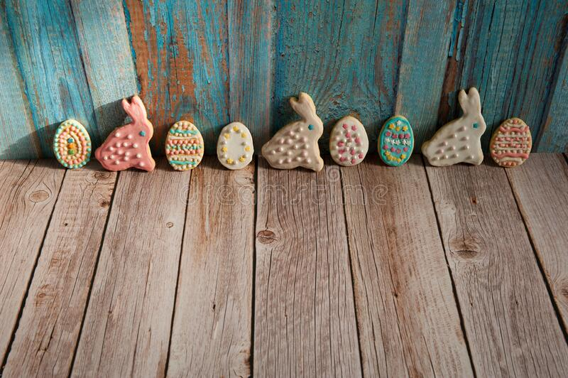 A collection of homemade cookies in the form of colorful eggs and funny Easter bunnies on a wooden background. Easter composition. A collection of homemade royalty free stock images
