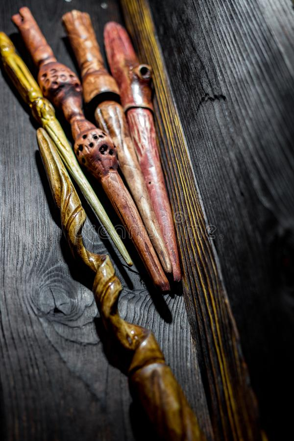 Collection of homemade magic wands. Vertical stock photo