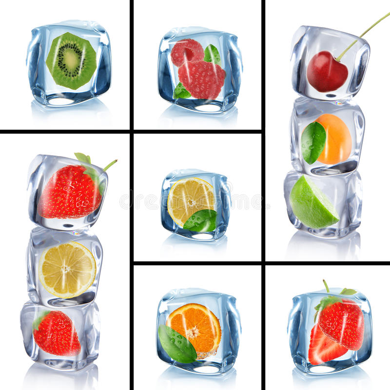 Ice cubes with frozen fruits. Collection of ice cubes with frozen fruits stock photography