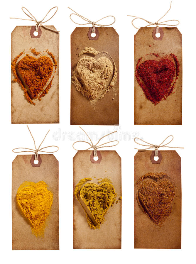 Collection of indian powder spices on vintage tags. Collection of indian powder spices - kebab masala, ginger, tandoori masala, turmeric, madras curry, tikka stock photography