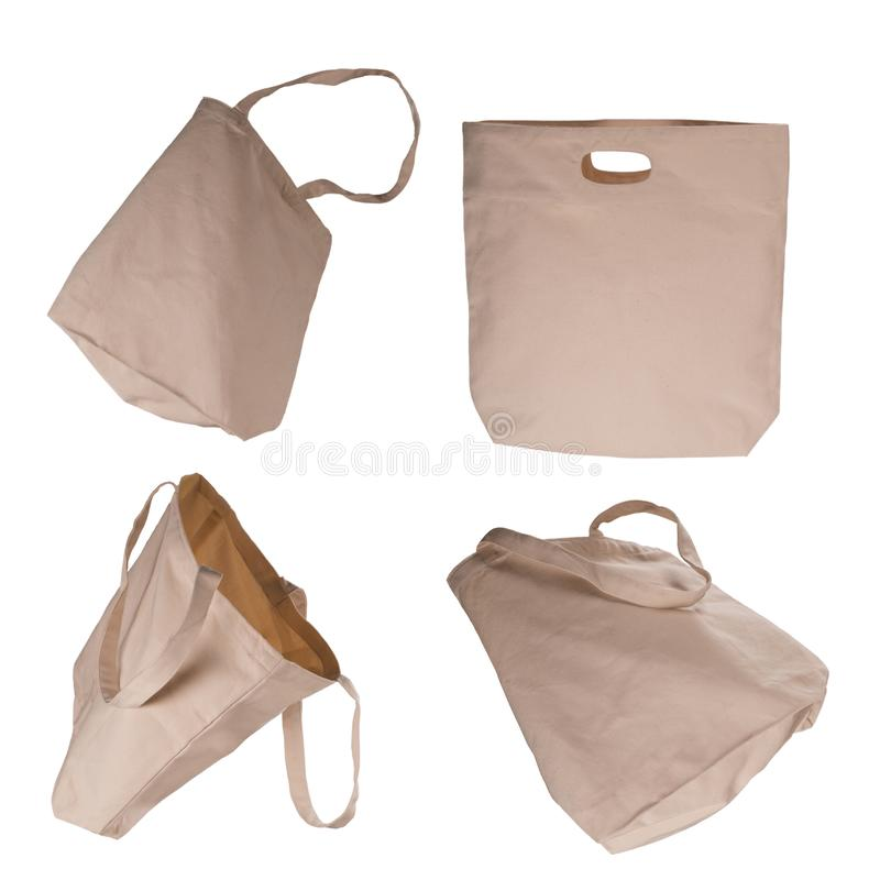 Collection of light beige cotton bags on white background. stock photo