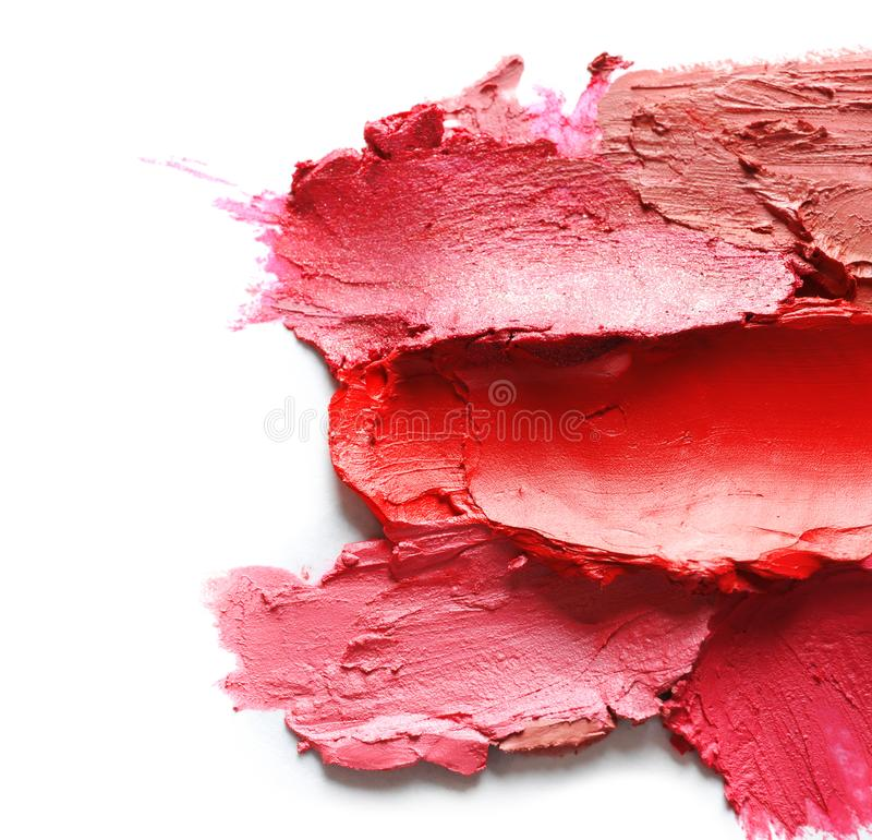 Collection of lipstick swatches on white background. Top view stock image