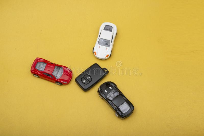 Collection of Multi Colored Modern Cars with with remote on yellow background.  stock image