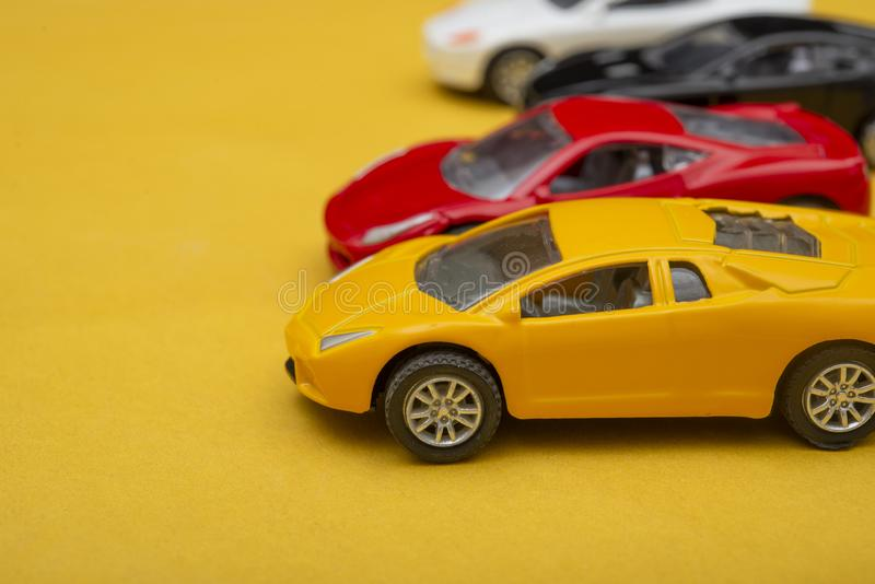 Collection of Multi Colored Modern Cars on yellow background.  stock images