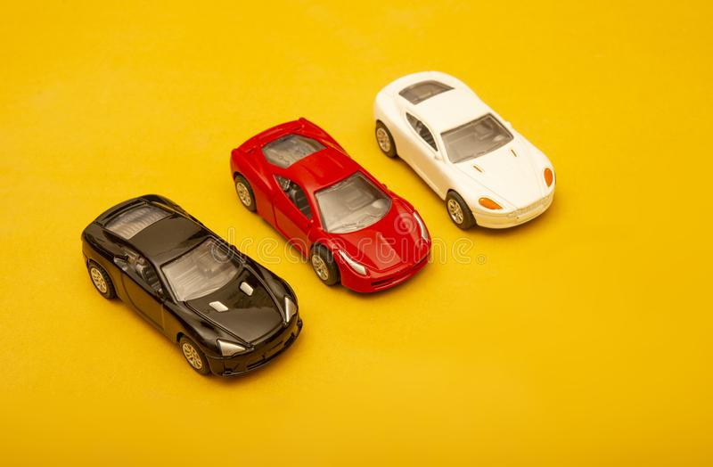 Collection of Multi Colored Modern Cars on yellow background.  stock photos