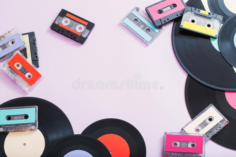 Collection of music tapes, records on paper background. Retro co royalty free stock photo