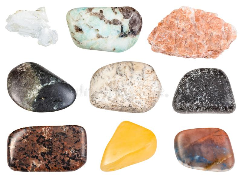 Set of various tumbled stones isolated on white royalty free stock photo
