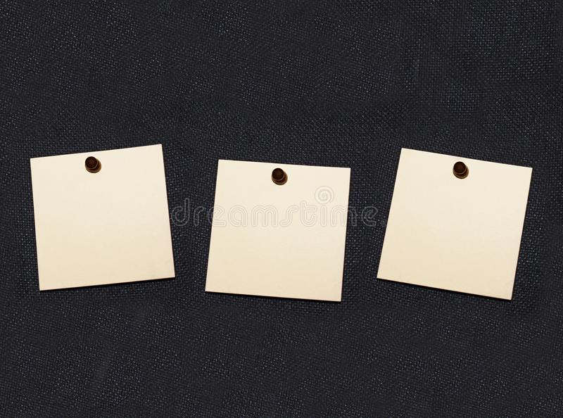 A collection of note papers pinned on black board for things you must remember. royalty free stock image