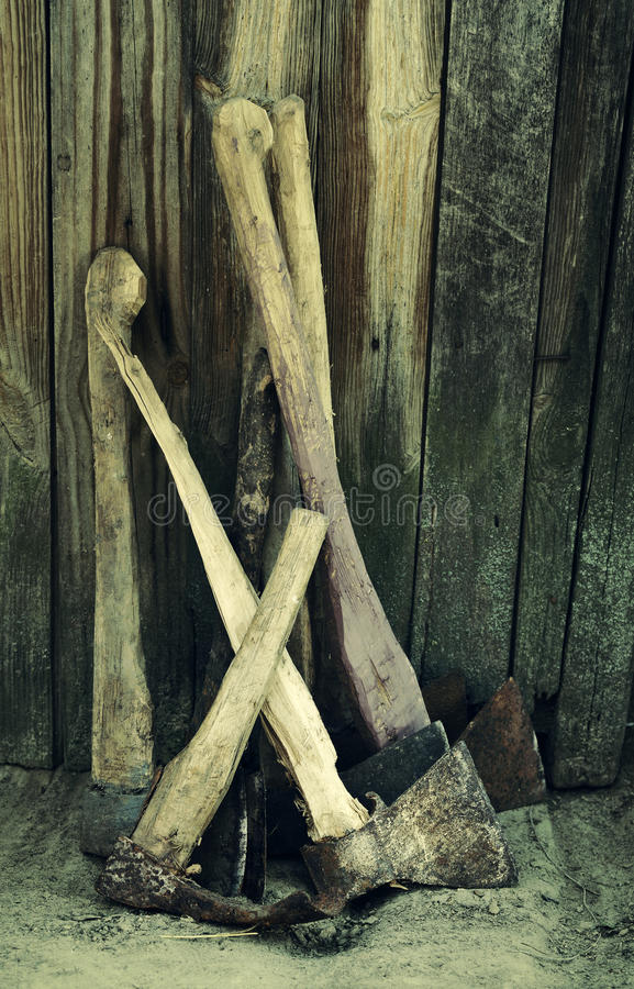 Collection of old axes. Against the background of a wooden fence stock photos