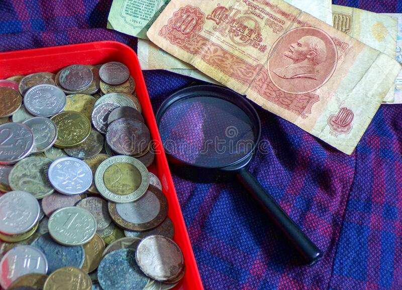 Collection of old coins and banknotes. Hobby of numismatics stock photography