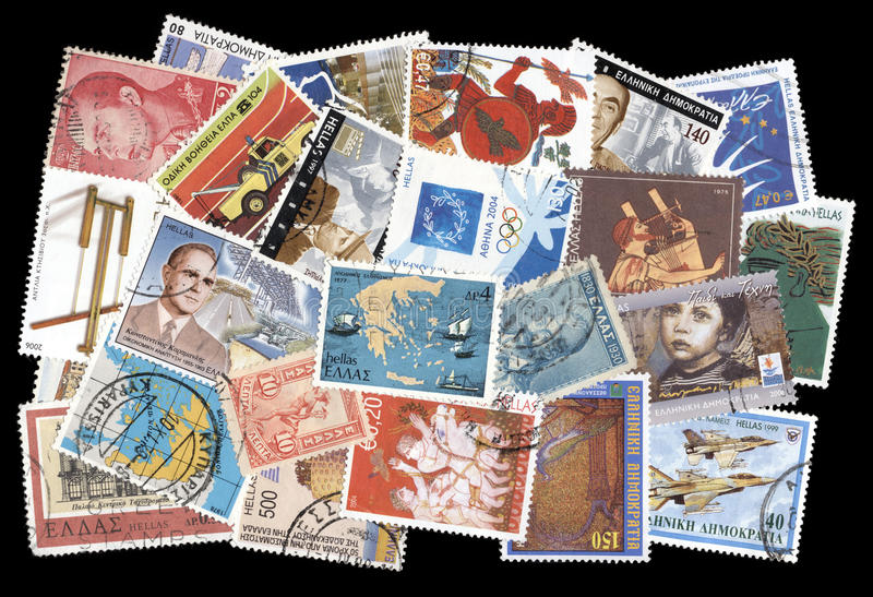 Collection of old postage stamps of Greece. Canceled postage stamps of Greece on black background stock photos