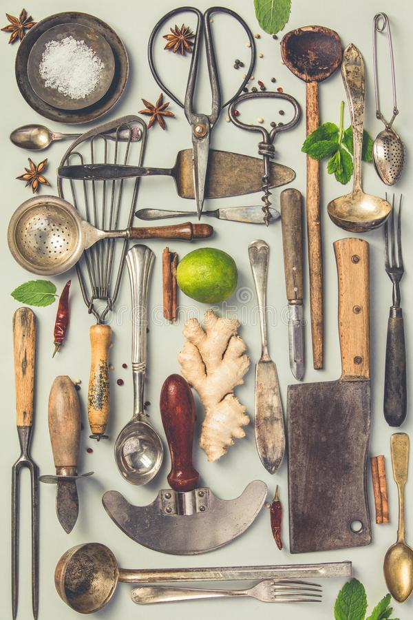 Collection of old vintage cutlery. On grey background. Top view, flat lay. Cooking concept stock photography