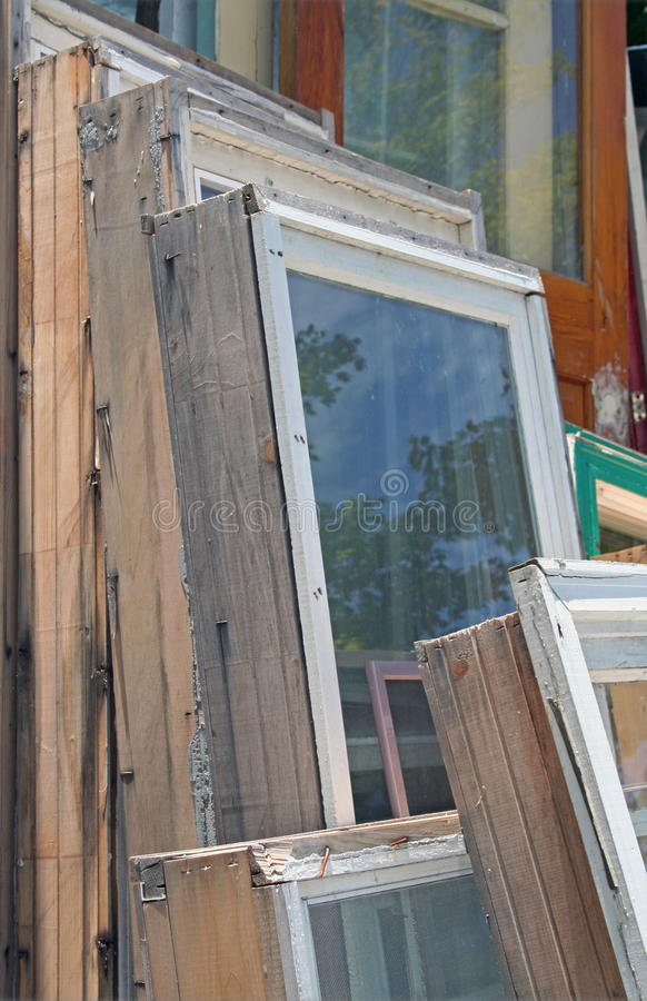 Collection of old wooden window frames. A pile of wooden window frames is stacked outside against each other royalty free stock images