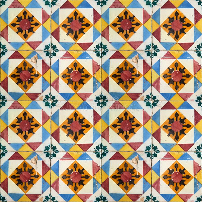 Collection of orange and blue patterns tiles. Photograph of traditional portuguese tiles in orange, yellow and blue royalty free stock photography