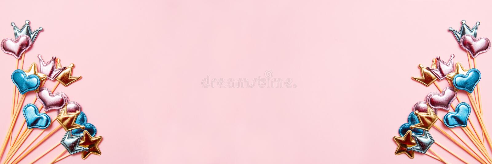 Collection of party objects on pink background. Birthday concept. Top view, banner stock photography