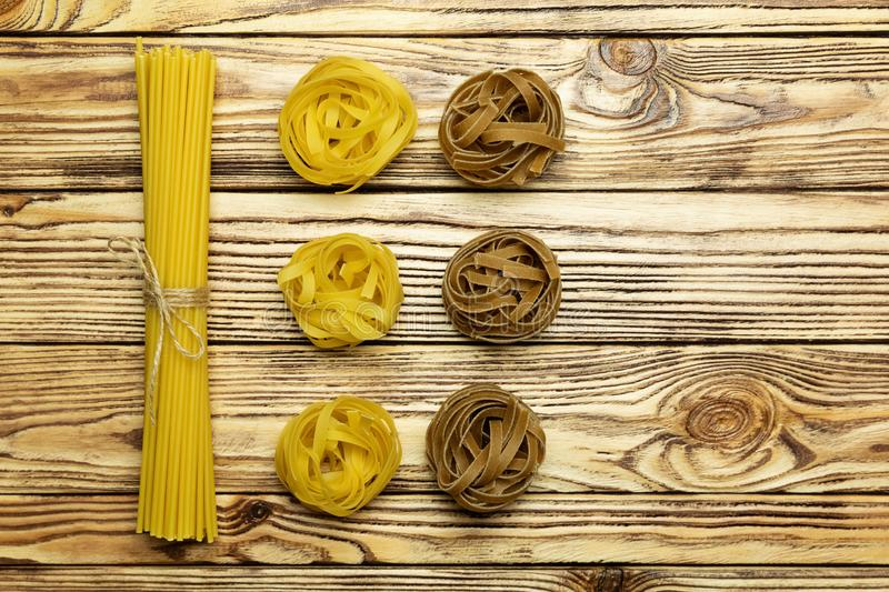 Collection of pasta on vintage wooden background. Variety of italian pasta. royalty free stock photos