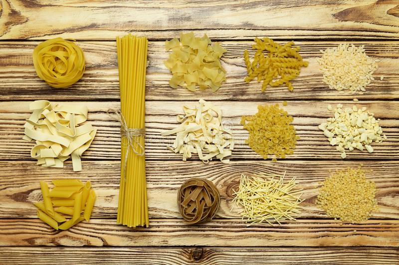 Collection of pasta on vintage wooden background. Variety of italian pasta. royalty free stock images