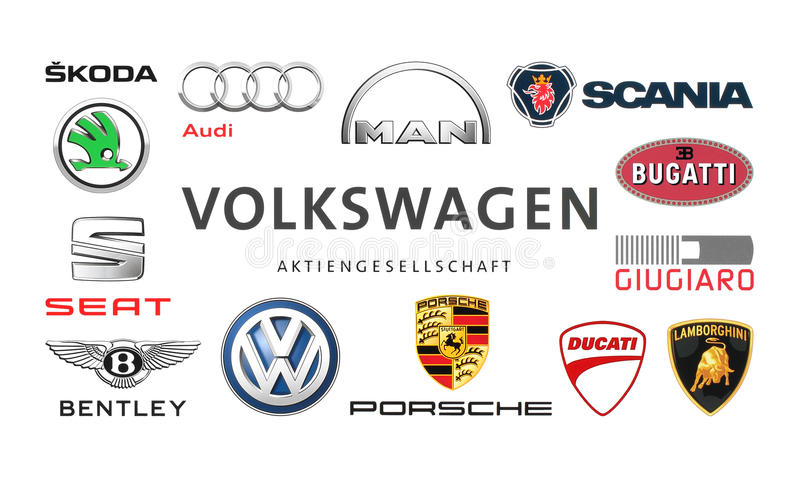 Collection of popular car logos. Kiev, Ukraine - February 24, 2016: Collection of popular car logos printed on white paper: Volkswagen, Audi, Seat, Bentley royalty free stock photos