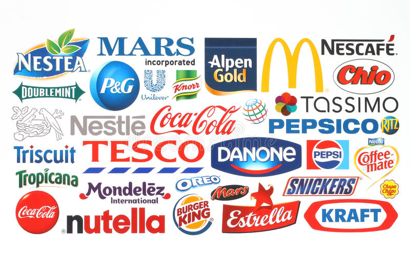 Collection of popular food logos companies printed on paper. KIEV, UKRAINE - MAY 07, 2015:Collection of popular food logos companies printed on paper:Coca-Cola