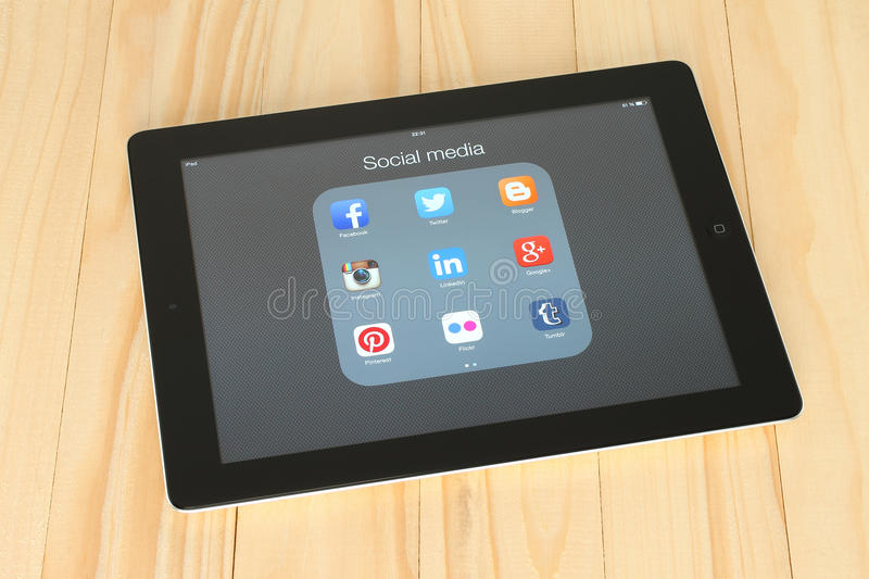 Collection of popular social media logos on iPad screen. KIEV, UKRAINE - APRIL 30, 2015: Collection of popular social media logos on iPad screen:Facebook royalty free stock images