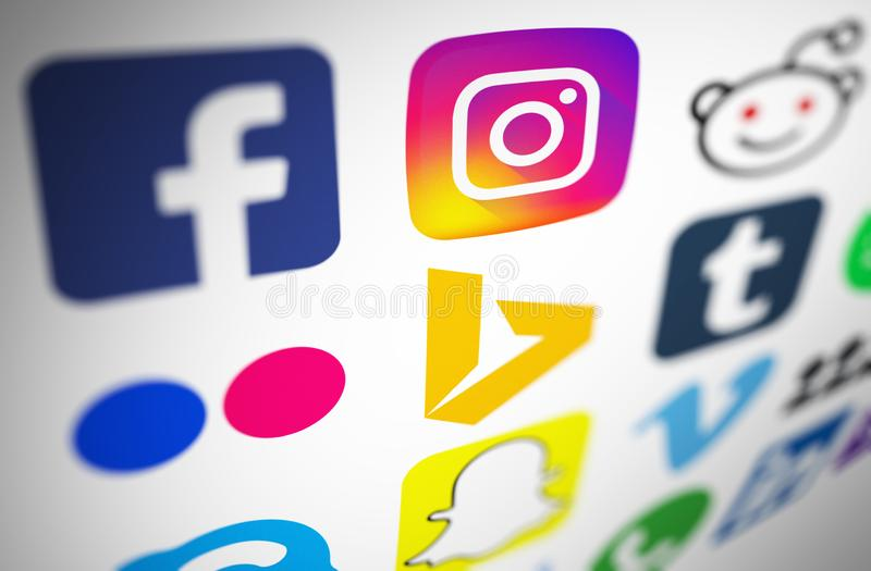 Collection of popular social networking icons printed on white paper royalty free stock image