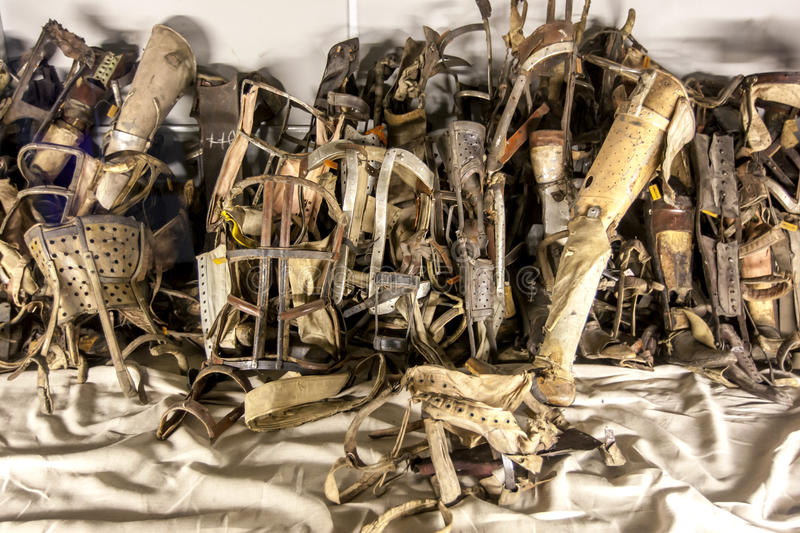 A collection of prothesis removed from prisoners at Auschwitz-Birkenau State Museum at Oswiecim in Poland. A collection of prothesis removed from prisoners at royalty free stock photo