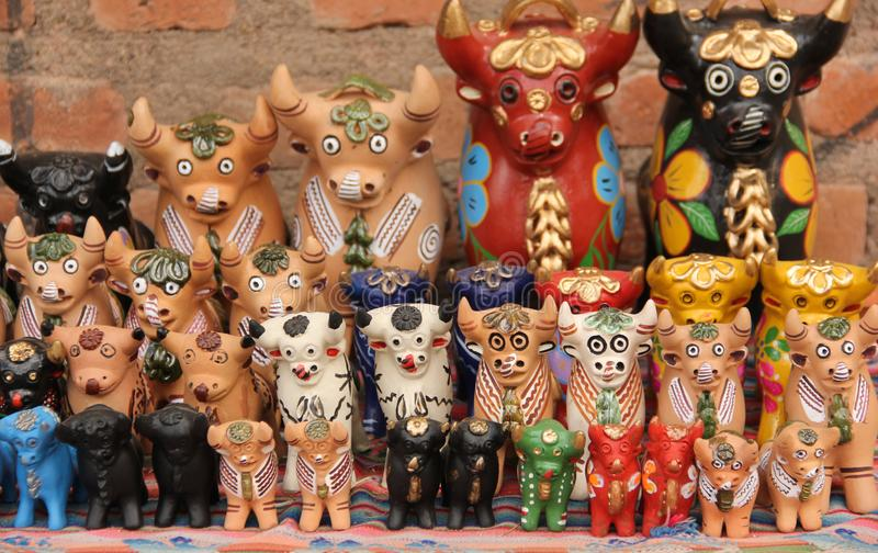 A collection of Pucara Bull statues. A collection of ceramic Pucara Bull Statue made to be placed on the roof for prosperity for sale at the souvenir market in royalty free stock image