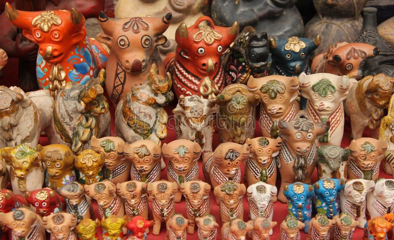 A collection of Pucara Bull statues. A collection of ceramic Pucara Bull Statue made to be placed on the roof for prosperity for sale at the souvenir market in royalty free stock photo