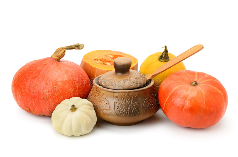 Collection pumpkins and clay pot royalty free stock image