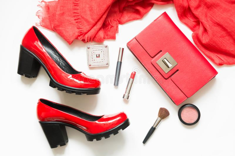 Set of red women`s accessories for new look, cocktail dress, special event or holiday. Flat lay. Top view. stock photo