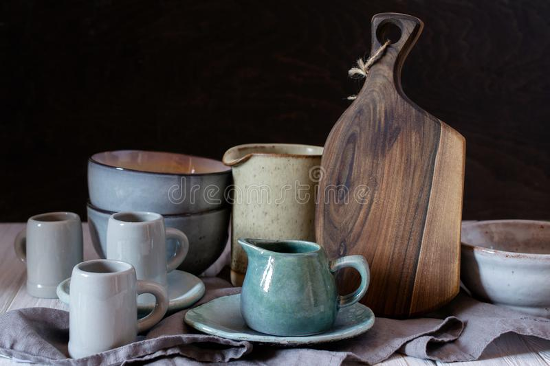 Collection of rustic simple handcraft kitchenware in neutral tones royalty free stock images