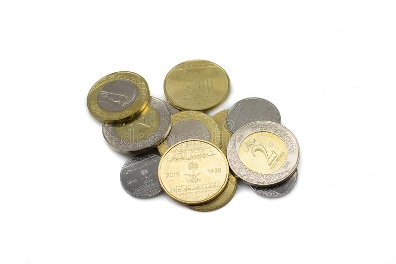 A pile of Saudi Arabian coins isolated on a white background stock images