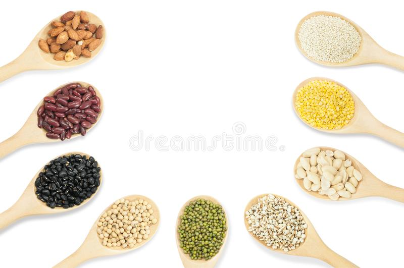 Collection set of beans and sesame on wooden spoons isolated on white stock image