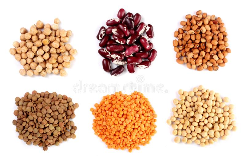 Collection set of Various dried kidney legumes beans, soybeans, lentils, chickpeas close up isolated on white background royalty free stock photography