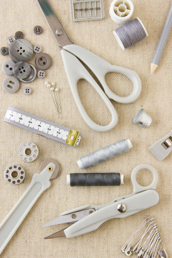 Needlecraft and sewing tools. A collection of sewing, needlecraft, dressmaking, tailoring tools and items in harmonising neutral greys and beige royalty free stock photos