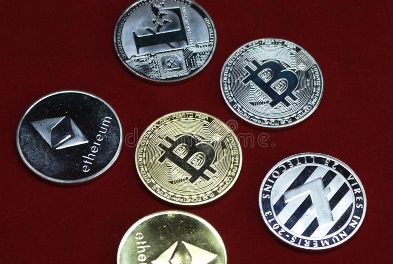 Collection of silver and gold cryptocurrency coins royalty free stock photography