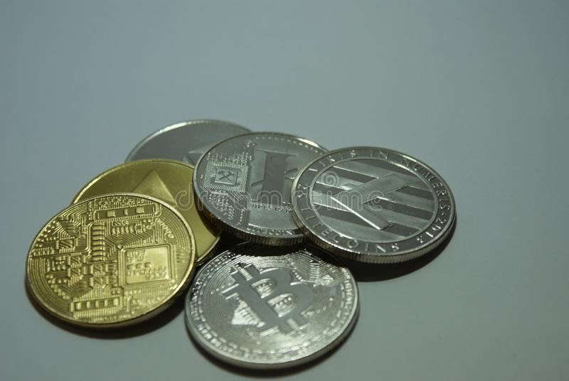 Silver and gold cryptocurrency coins on a white background royalty free stock photography