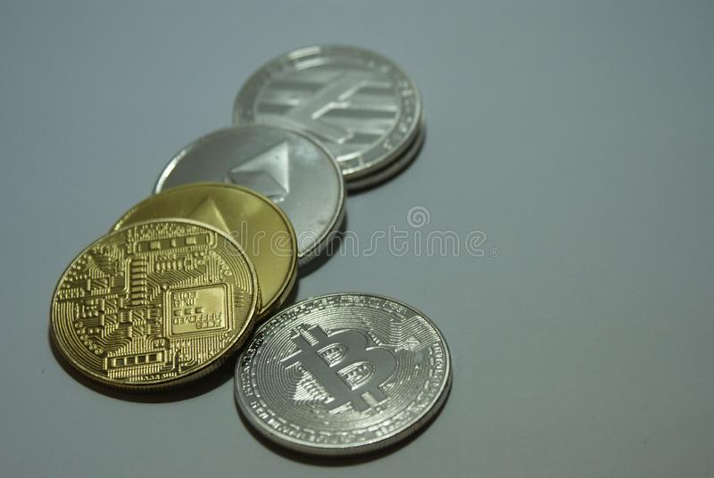 Silver and gold cryptocurrency coins on a white background stock photos