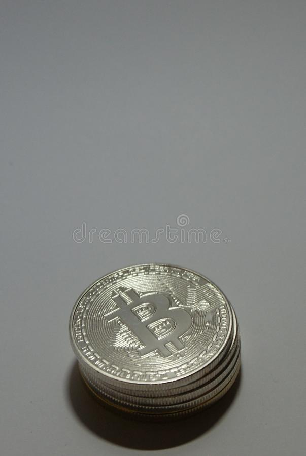 Silver and gold cryptocurrency coins on a white background stock photo
